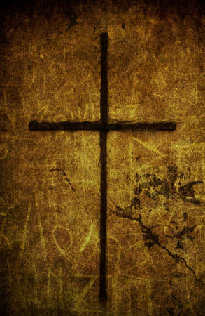 A cracked yellow grunge wall with metal cross Stock Photo - 7654668
