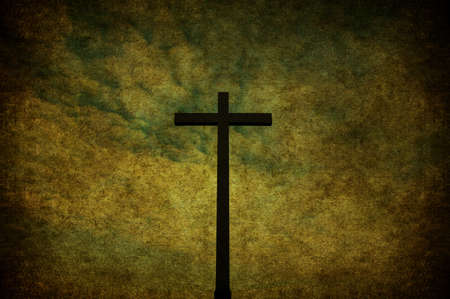 A cracked yellow grunge wall with metal cross Stock Photo - 7654656