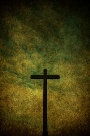 A cracked yellow grunge wall with metal cross Stock Photo - 7654840