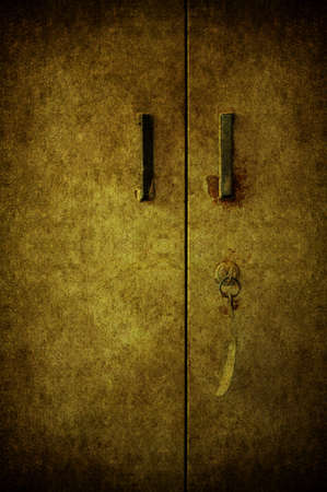 A grunge door closed with the key Stock Photo - 7654896