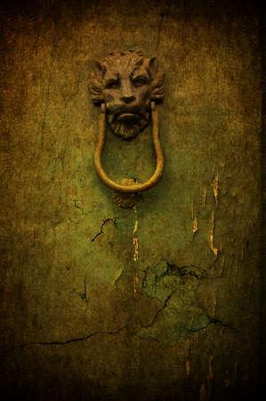 A cracked yellow grunge door with metal handle Stock Photo - 7654861