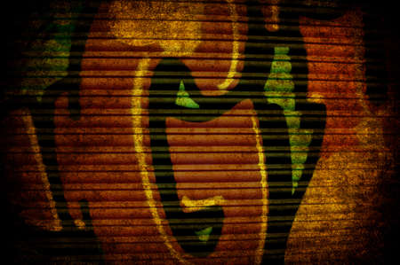 A grunge old rusted yellow metal shutter photo