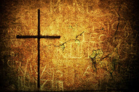 A cracked yellow grunge wall with metal cross Stock Photo - 7655080