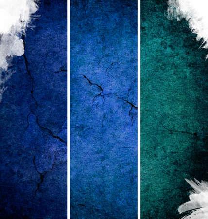 Three vertical blue banners vith cracks photo