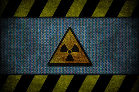 A blue metal with yellow and black danger strips photo