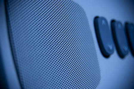 A blue loudspeaker with some key in background Stock Photo - 7725288