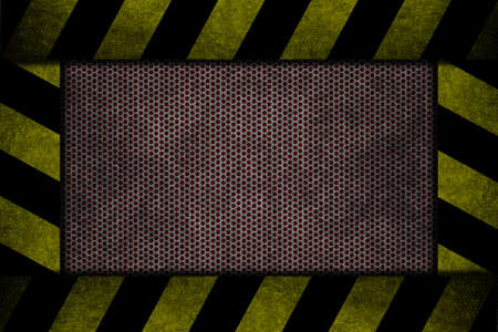 A red metal with yellow and black danger strips photo
