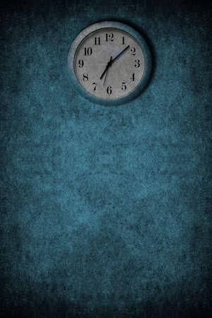 A grunge image with blue and white clock on a wall photo