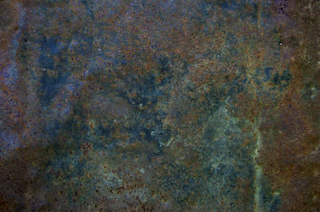 A colored texture of rusted plate of metal photo