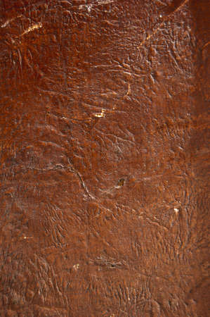 A close up of a brown raw leather photo