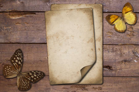 An isolated old grunge paper on a wooden background photo