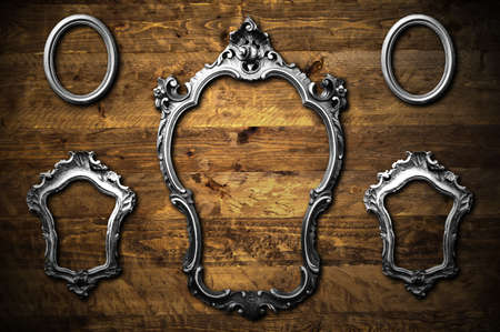 A collection of metal frames on a wooden background Stock Photo - 8017663