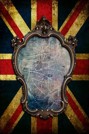 A vintage golden frame on a dark United kingdom flag Stock Photo - 8017670