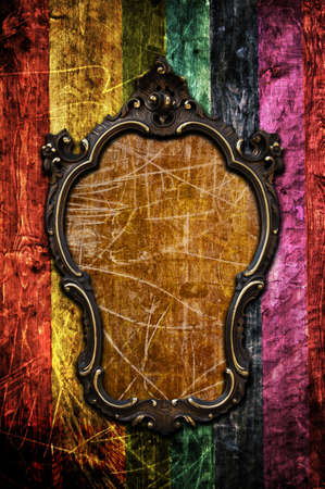 A vintage golden frame on a colored wooden wall Stock Photo - 8017676