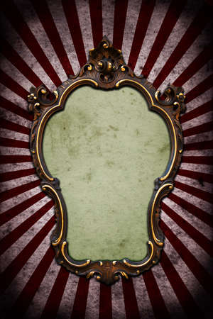yellow photo: A vintage golden frame on a dark wall with ray Stock Photo