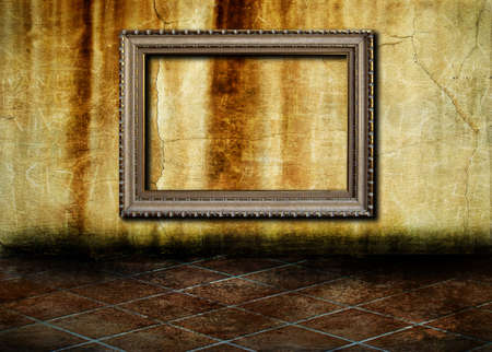 A vintage golden frame on a grunge concrete wall Stock Photo - 8017671