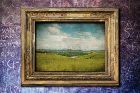 A vintage golden frame on a dark purple wall Stock Photo - 8017672