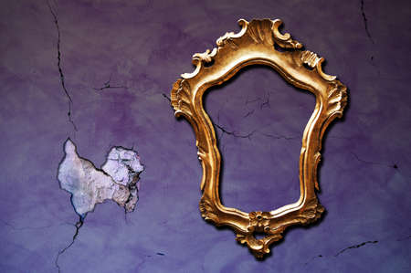 A vintage golden frame on a cracked purple wall Stock Photo - 8017657