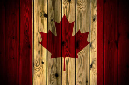 A Canada flag painted on a wooden wall photo