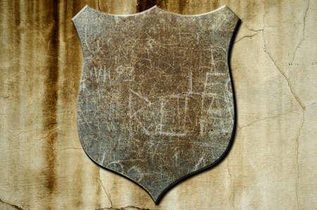 A metal shield on a concrete background photo