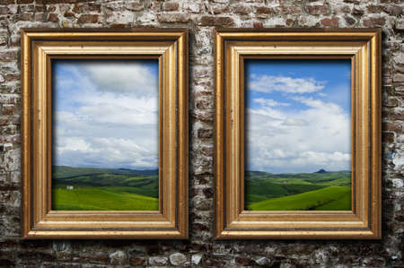 Two golden frames on a dark brick wall Stock Photo - 8255362