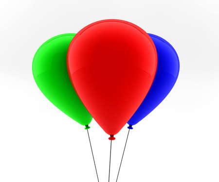 three colored: three colored balloons fly in the air