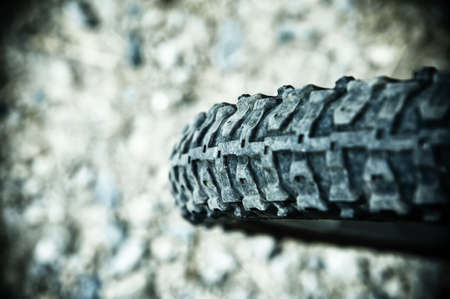 A close up of a back bike tire