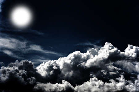 Image of a dark cloudy sky with moon photo