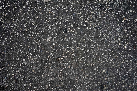 A detailed dark asphalt texture grey and black