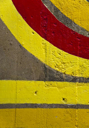 Grunge yellow and red lines on a wall