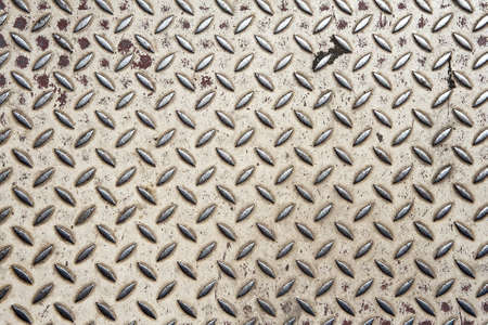Background of old metal diamond plate in grey color photo
