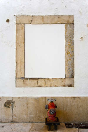 White copyspace in a stone frame with a red hydrant photo