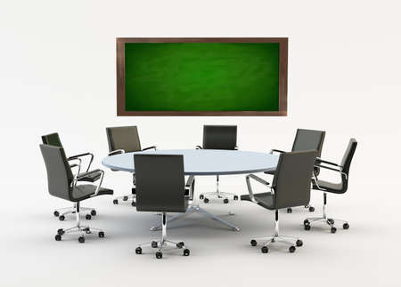 Black chairs around a light office table with a chalkboard photo