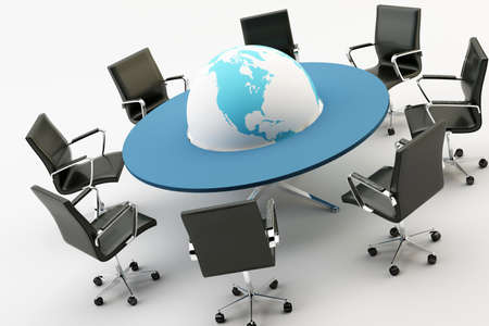 Black chairs around a light office table and a world photo