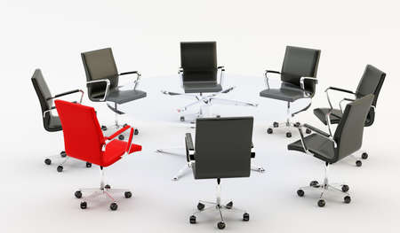 Black chairs around a light office table