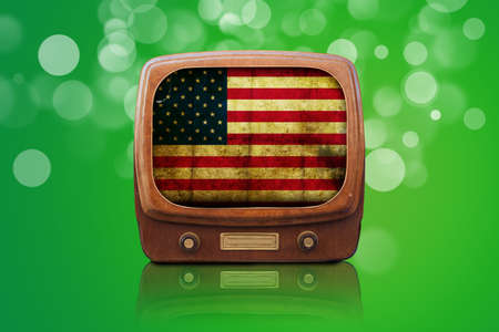 Old Tv isolated on a green bokeh background photo