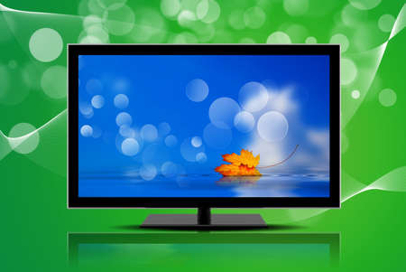 A television isolated on a green background Stock Photo - 11739824