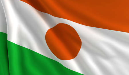 niger: A flag of Niger in the wind Stock Photo