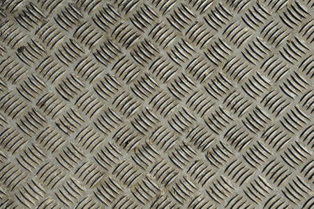 Background of old metal diamond plate in brown color photo