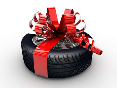 A tyre with a red ribbon like a present photo