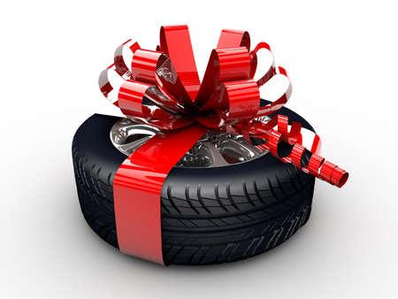 Un pneumatico con un nastro rosso come un regalo