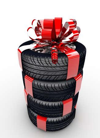 Quattro pneumatici con un nastro rosso come un regalo Archivio Fotografico
