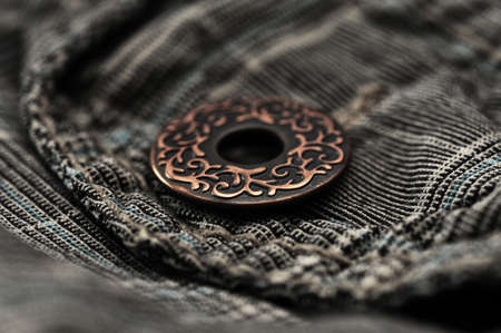 close button: Photo of a pocket jeans with metallic button Stock Photo