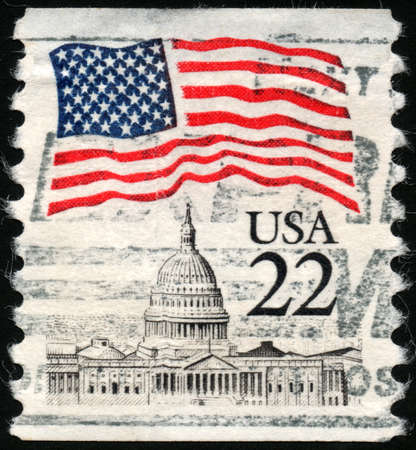 UNITED STATES OF AMERICA - CIRCA 1985  A stamp printed in the USA shows Flag over Capitol, circa 1985