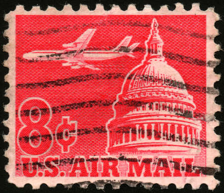 USA - CIRCA 1962  A stamp printed in USA shows an airplane flying across the Senate building, circa 1962 photo
