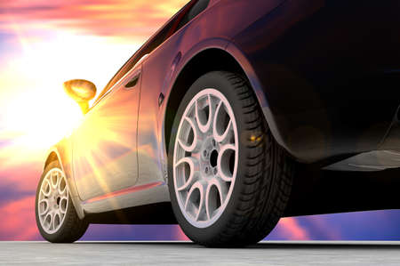 rear wheel: A black car seen by back in front of a sunset Stock Photo
