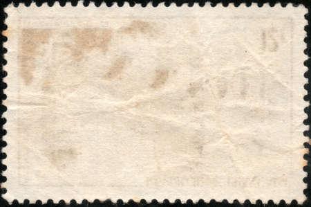 Bianche francobollo grunge isolato su uno sfondo nero photo