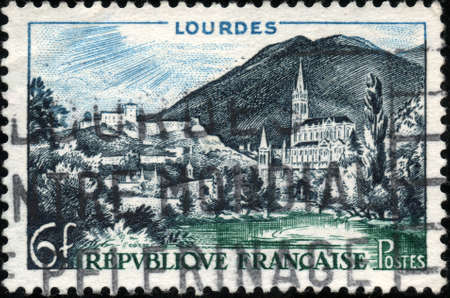 A stamp showing Lourdes eh France