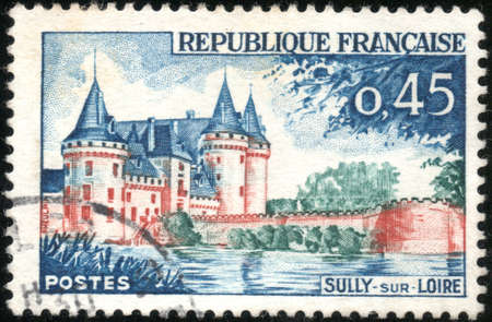 sully: A stamp showing Sully sur Loire en France