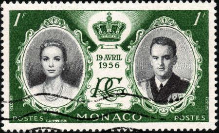 CIRCA 1956  A stamp printed in Monaco showing prince Ranier of Monaco and princess Grace Kelly, circa 1956 Stock Photo